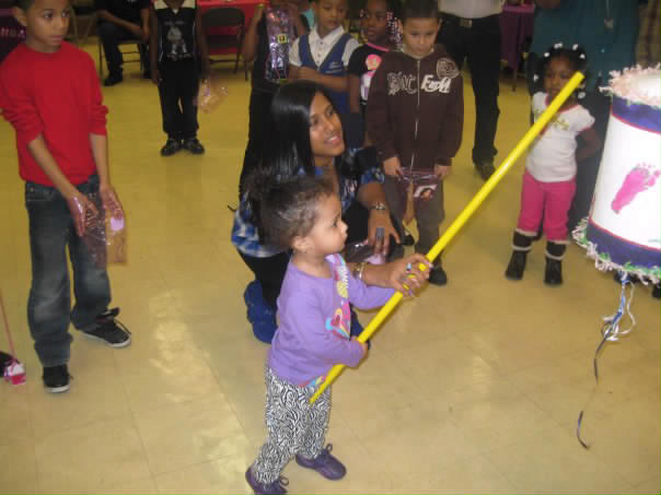 gabby hitting the pinata